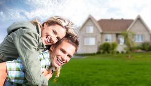 bigstock-Happy-family-near-new-house-R-36426763
